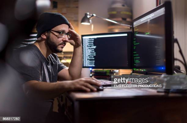 concentrated hacker is working with his computer system - cyber attack