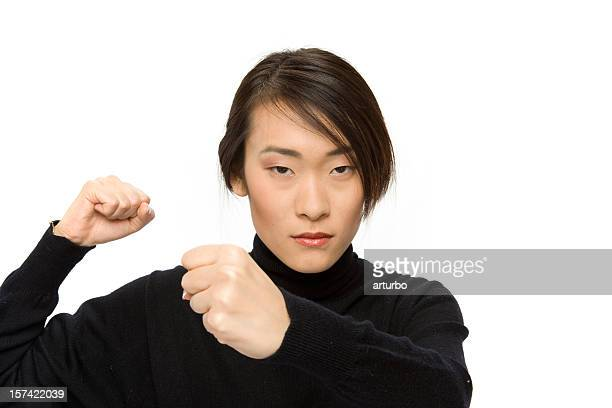 concentrated woman in boxing pose