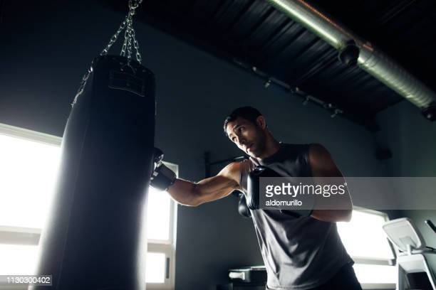 concentrated young man box training in the gym - boxing stock pictures, royalty-free photos & images
