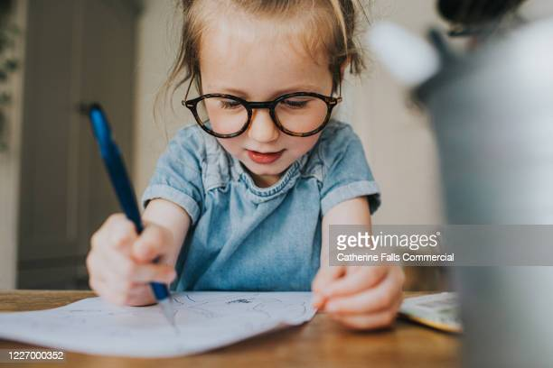 concentrating child - drawing stock pictures, royalty-free photos & images