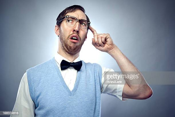 concentrating nerd student scratching head - nerd stock pictures, royalty-free photos & images