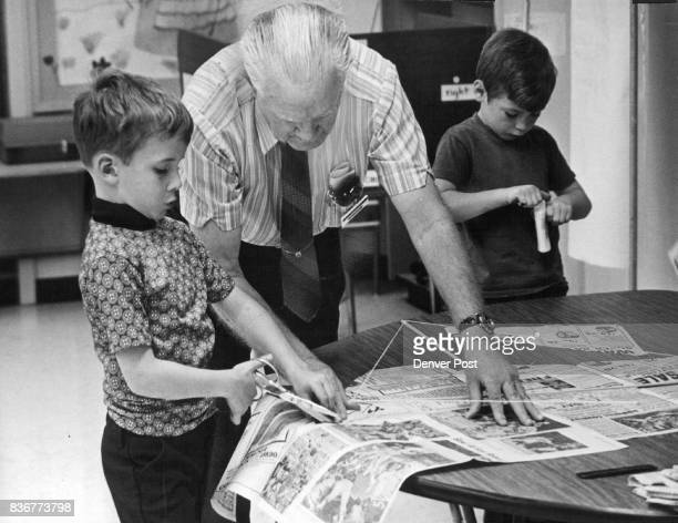 Concentrating on kite construction from left are Rickey Voss Allan Russell and Mark McNulty Credit Denver Post