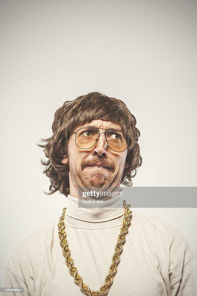 Concentrating Retro Seventies Man : Stock Photo