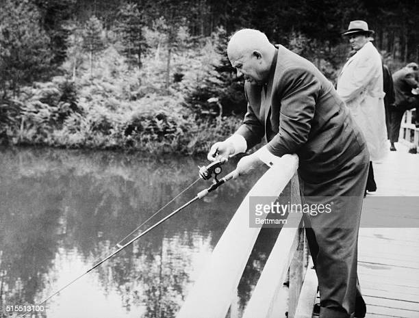 Concentration. Brdo, Yugoslavia: Soviet premier Nikita Khrushchev appears to be in deep concentration as he tries his hand at fishing during a visit...