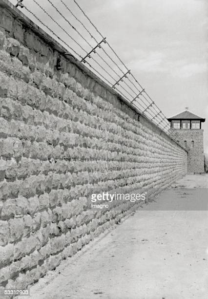 Concentration camp Mauthausen watchtower and stone wall with barbed wire Photography around 1940 [Konzentrationslager Mauthausen Wachtturm und Mauer...