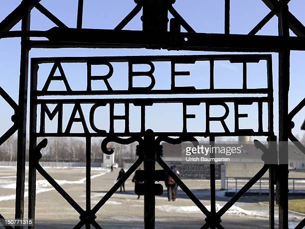 GERMANY DACHAU Concentration camp memorial place Dachau Ops Gate of the former concetration camp Dachau with the writing sign Arbeit macht frei Work...
