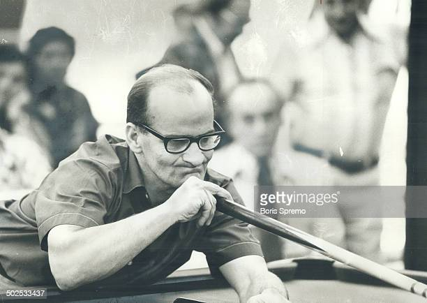 Concentration John Dillon of Toronto is picture of concentration as he lines up shot during yesterday's play in CNE snooker tournament Dillon won the...