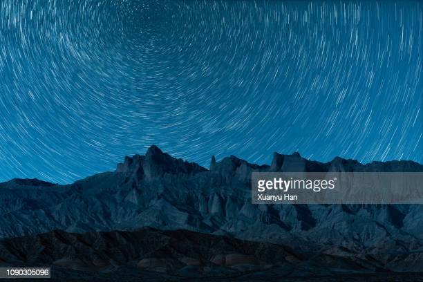 a concentric star trail rotating around the star polaris - space exploration stock pictures, royalty-free photos & images