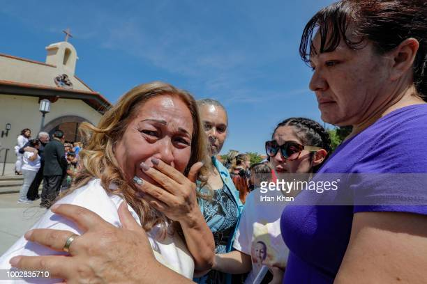 Concepcion Ramirez left grand mother of 10yearold Anthony Avalos weeps at the end of funeral services held at Saint Junipero Serra Parish on July 20...
