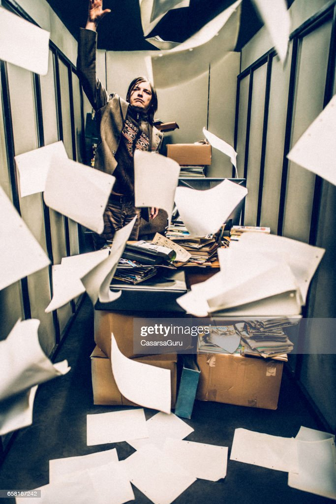 Concept image of a Stressful Day in a Tiny Office : Stock Photo