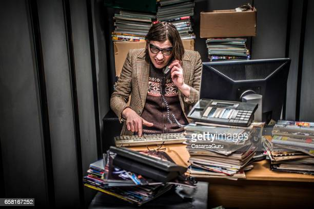 concept image of a stressful day in a tiny office - editor stock pictures, royalty-free photos & images