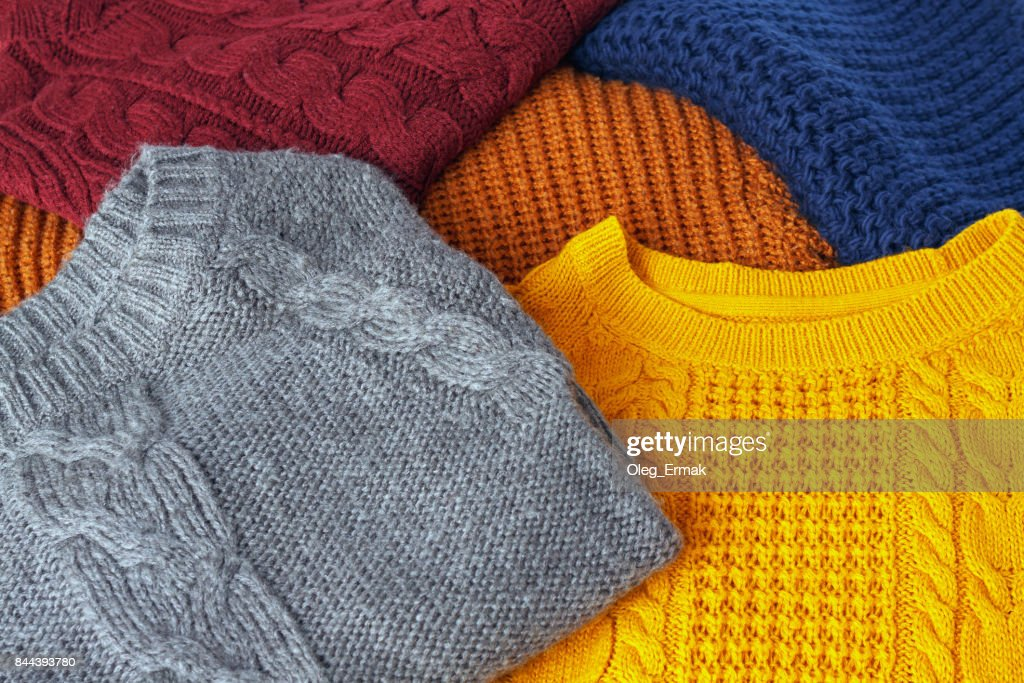 Concept knitted wool colorful warm sweaters closeup : Stock Photo