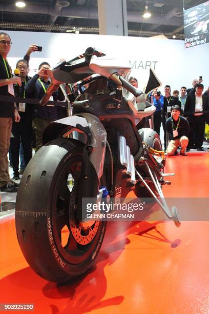 A concept motorcycle with autonomous capabilities balances itself and draws a crowd at the Yamaha booth at the Consumer Electronics Show in Las Vegas...