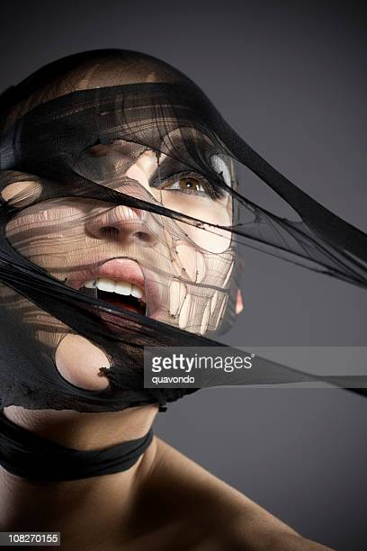 beautiful young woman model ripping through net, head shot - pantyhose mask stock pictures, royalty-free photos & images