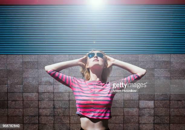Concept of cool eyeglasses . Joyful girl with black sunglasses