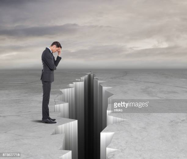 concept of crisis in business - crevasse stock photos and pictures