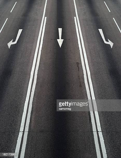 concept of different directions using painted arrows on road - intersection stock pictures, royalty-free photos & images