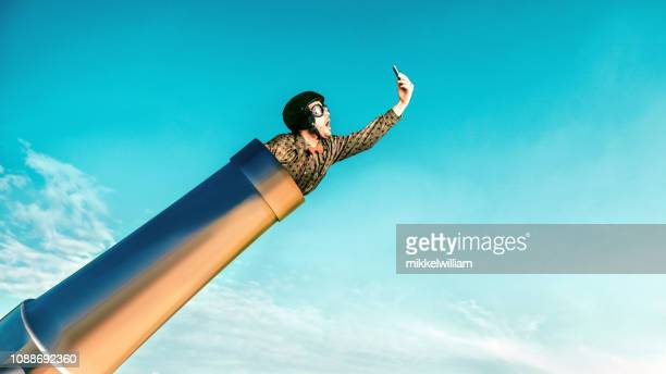 concept of fast 5g connection on mobile phone illustrated by daredevil and a cannon - funny stock pictures, royalty-free photos & images