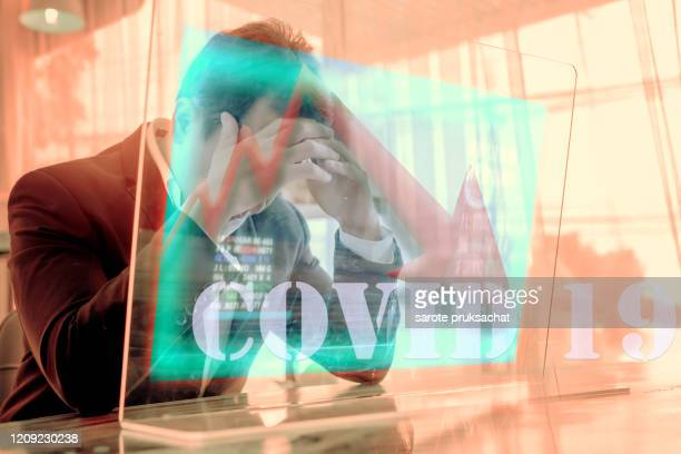 concept of financial problems. man holding his head while the markets plunge serious covid-19 ,corona virus effect health investment . - crisis stock pictures, royalty-free photos & images