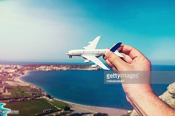 Concept of going on vacation by airplane in the summer