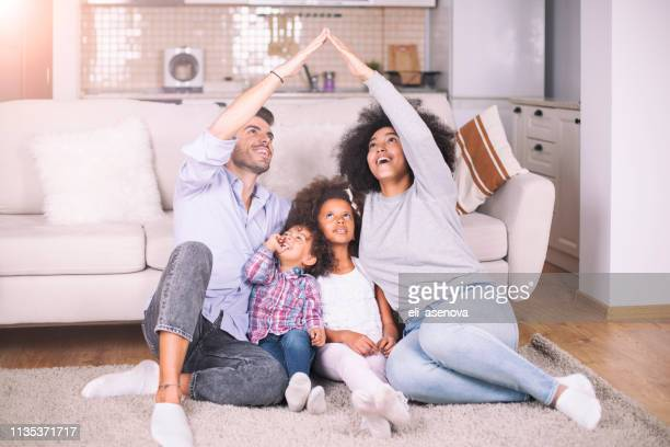 concept of housing for young family - mixed race person stock pictures, royalty-free photos & images