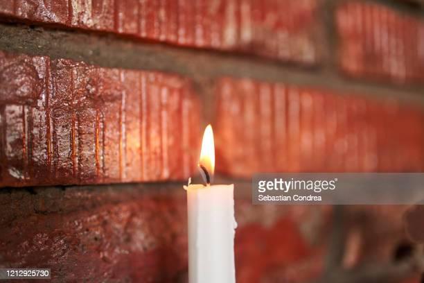 concept of light of hope, worship, prayer. easter event in romania. - candle of hope imagens e fotografias de stock