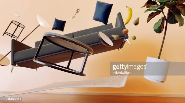 konzept des wohnzimmers mit möbeln, die durch die luft fliegen - furniture stock-fotos und bilder