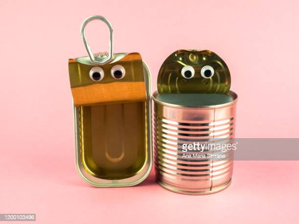 concept of love, romanticism and diversity. two open tin cans with eyes - キャニスター ストックフォトと画像