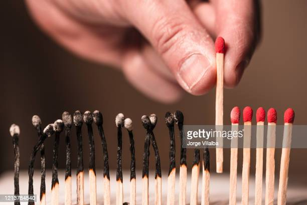 concept of matches in a row indicating separation from others - crisis stock pictures, royalty-free photos & images