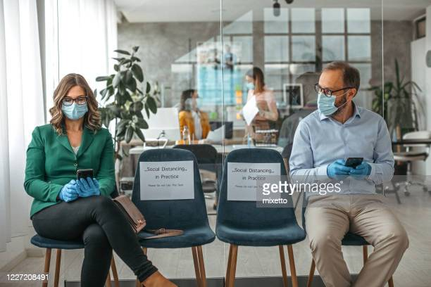 concept of social distancing to prevent spread of infectious disease - small group of people stock pictures, royalty-free photos & images