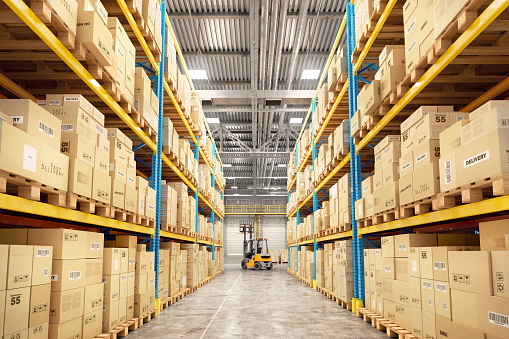 Concept of warehouse. The forklift between rows in the big warehouse 893494012