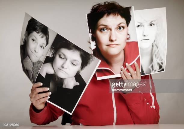 Concept of woman holding pictures of multiple personalities
