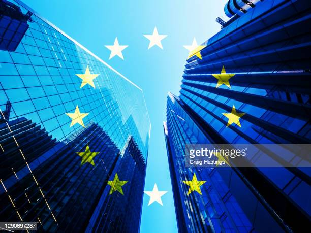 concept piece containing a city of london skyscraper scene with the eu flag overlaid as both the uk and eu try to negotiate a trade deal before brexit on the 1st january 2021 - tariff stock pictures, royalty-free photos & images