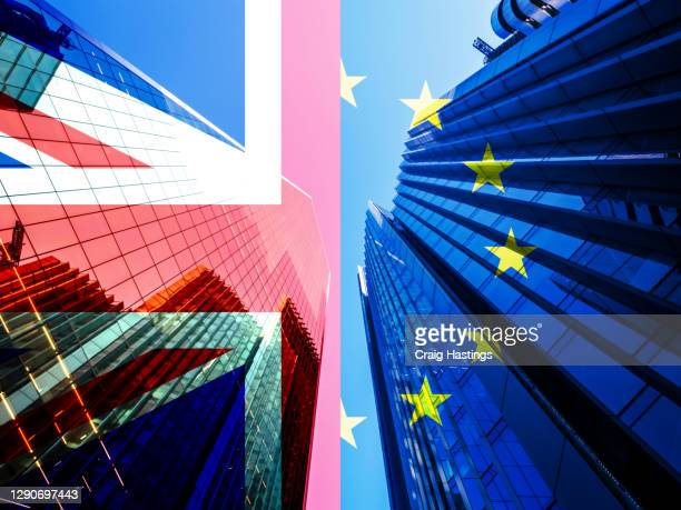 concept piece containing a city of london skyscraper scene with the union jack and eu flag overlaid as both the uk and eu try to negotiate a trade deal before brexit on the 1st january 2021 - brexit stock pictures, royalty-free photos & images
