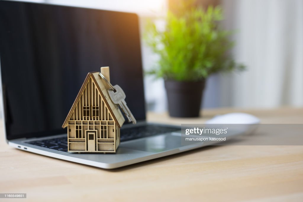 Concept shopping online,House model on laptop : Stock Photo
