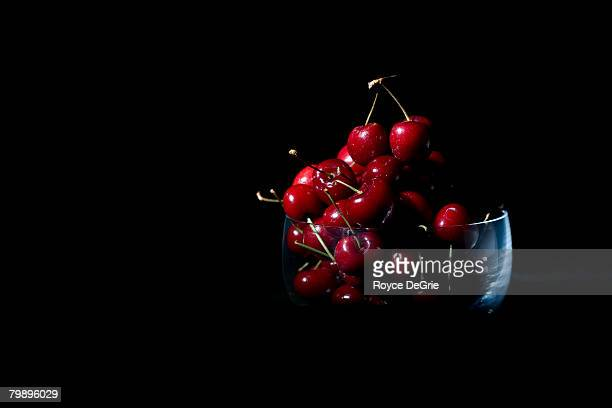 Concept shot for the phrase Life is a bowl of cherries. Shot against a black background.
