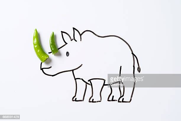Concept sketch of  rhinoceros with green chili