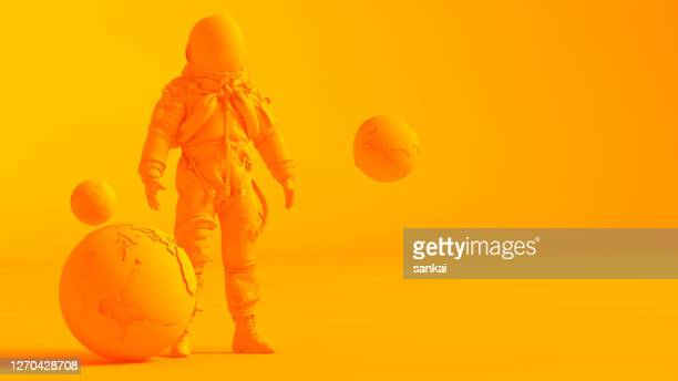 concept stereoscopic image. low poly earth and astronaut model isolated on orange background. - three dimensional stock pictures, royalty-free photos & images