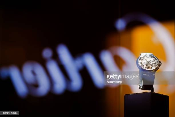 A concept wristwatch sits on display at the Cartier booth a unit of Cie Financiere Richemont SA on the first day of the Salon International de la...