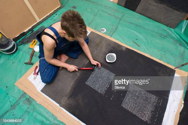 Conceptual artist working in art studio