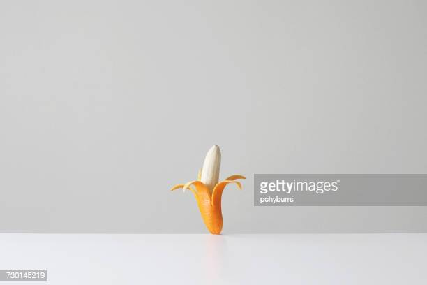 Conceptual banana in an orange skin