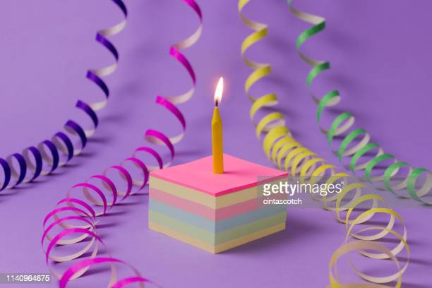 conceptual birthday cake and streamers - anniversaire humour photos et images de collection