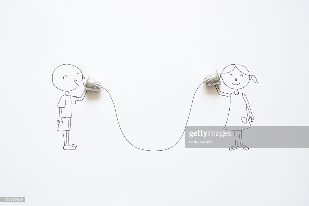 Conceptual boy and girl talking with tin can phones : Stock Photo