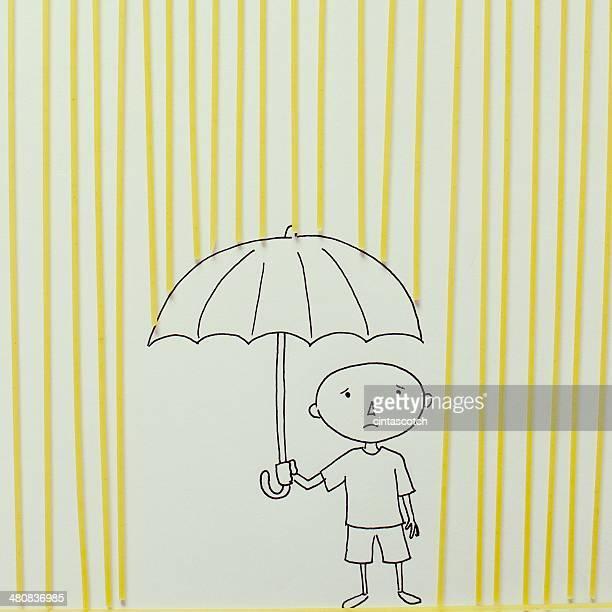 Conceptual boy standing in rain holding an umbrella