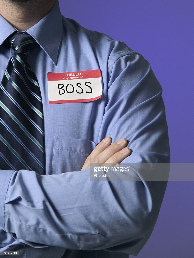 conceptual business shot of a male in a shirt and tie with a name tag stating he is the boss : Foto de stock