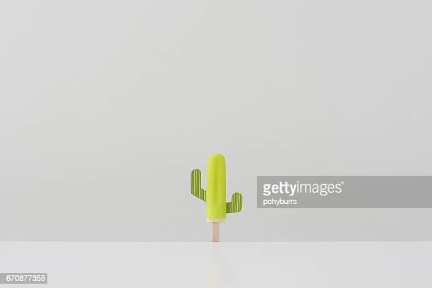 conceptual cactus shape ice lolly - eis am stiel stock-fotos und bilder