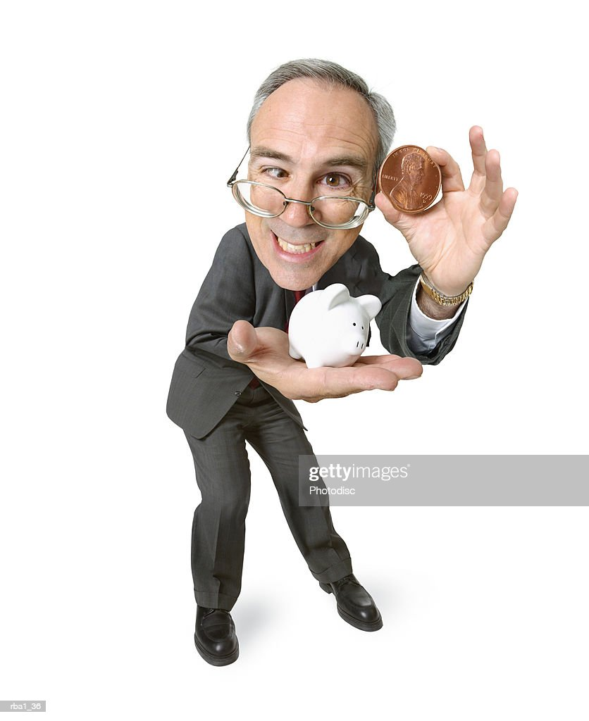 conceptual caricature of a caucasian business man in a suit as he holds out a small piggy bank and clutches a big penny : Stock Photo