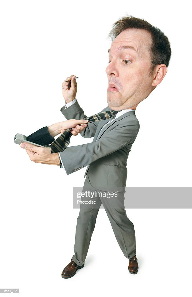 conceptual caricature of a caucasian man in a suit as he gets attacked by an arm coming out of his palm pilot : Stockfoto
