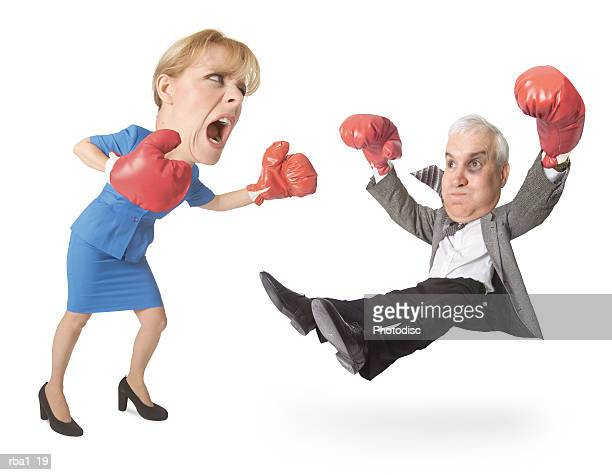 conceptual caricature of caucasian businessman in suit he boxes gets punched out by a businesswoman