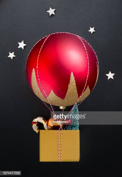 conceptual christmas decoration hot air balloon still life. - pursuit concept stock pictures, royalty-free photos & images